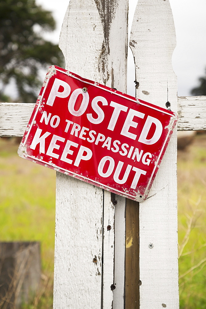 Sign On An Old White Picket Fence Saying Posted Keep Out No Trespassing, Monterey Bay, California, United States Of America