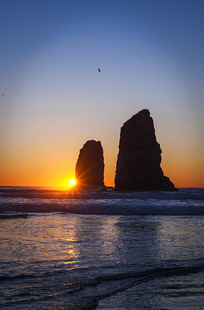 The Sunset Over Sea Stacks, Cannon Beach, Oregon, United States Of America