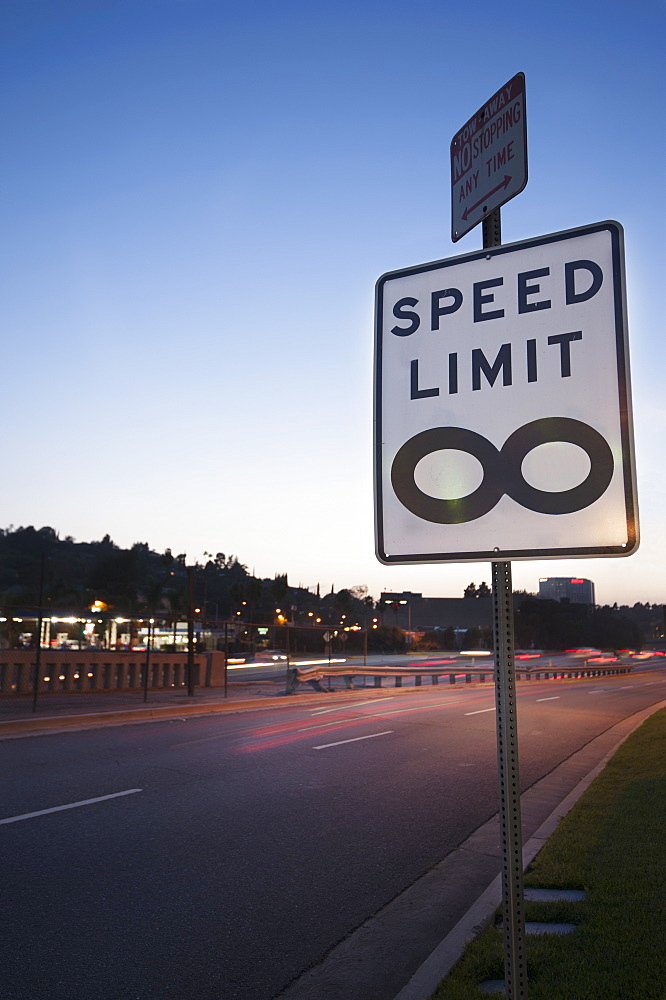 Traffic sign stating 'speed limit infinity' at barham boulevard freeway entrance, Los angeles california united states of america