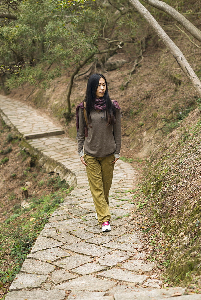 Young Woman Walking On A Trail, Xiamen, China