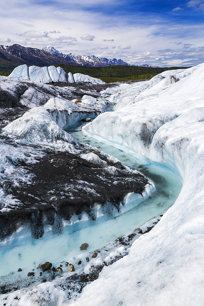 View Of A River Flowing Through An Ice Channel From The Matanuska Glacier, Alaska, United States Of America