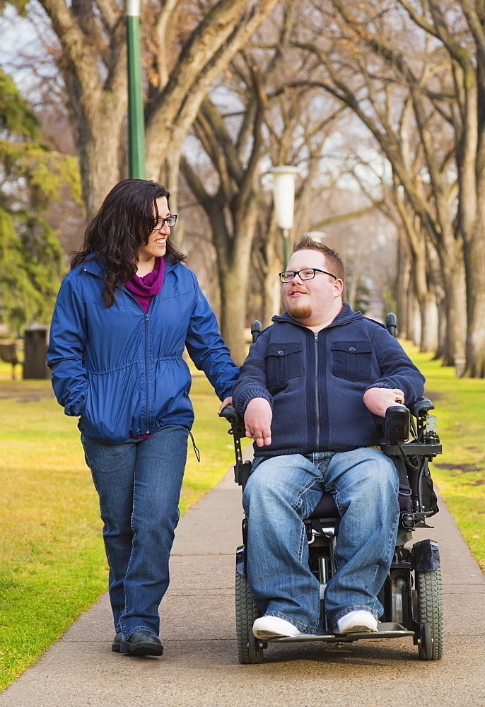 Disabled Husband Talking With His Wife While Walking In A Park In Autumn, Edmonton, Alberta, Canada