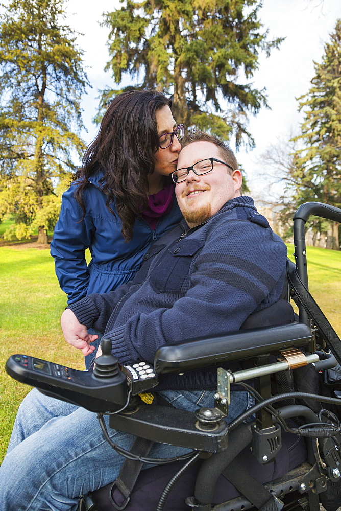 Disabled Husband With His Wife In A Park In Autumn, Edmonton, Alberta, Canada