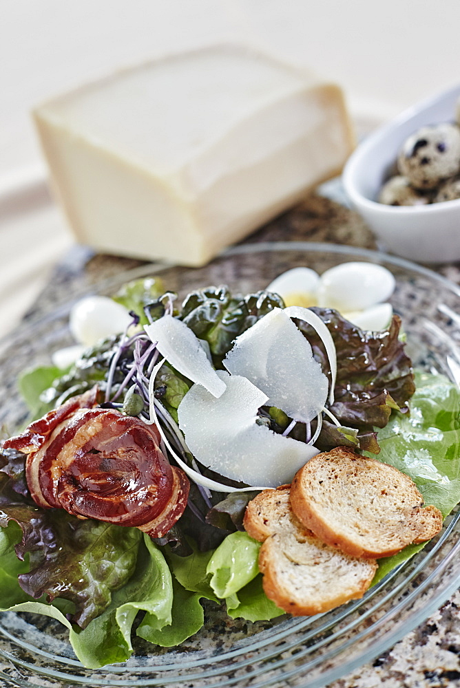 Salad With Shaved Parmesean Cheese, Bacon, Bread Crisps, And Quail Eggs, Ontario, Canada