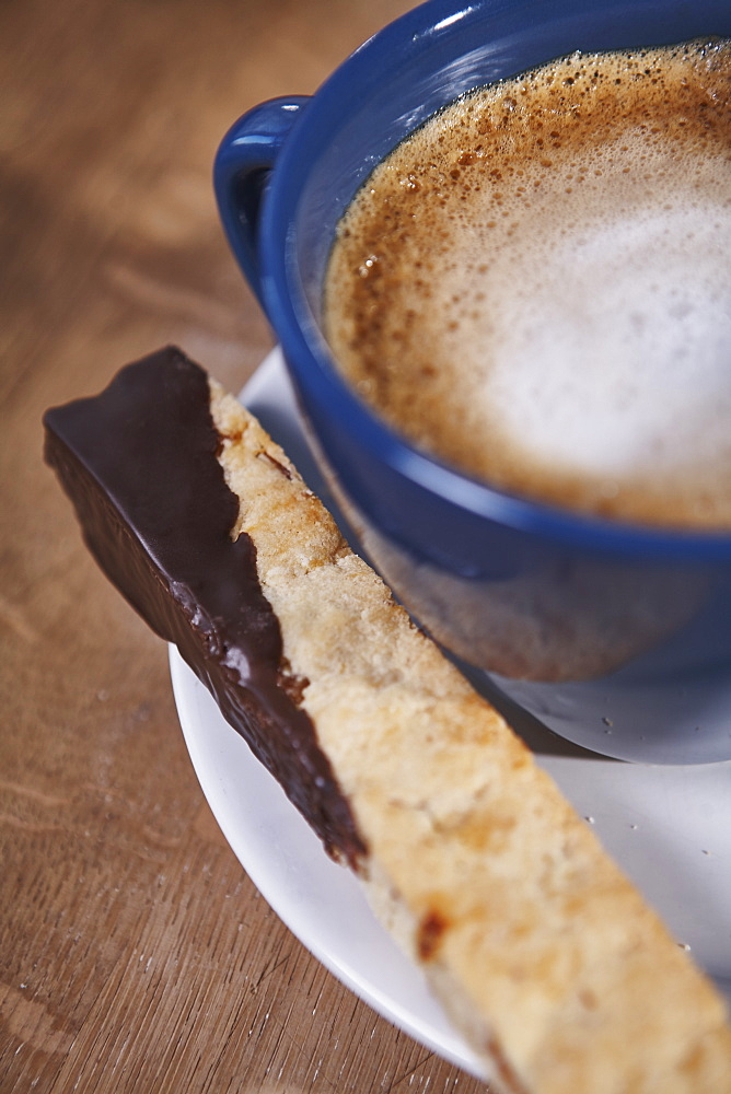 Cappuccino And Chocolate Dipped Biscotti On A White Plate, Ontario, Canada
