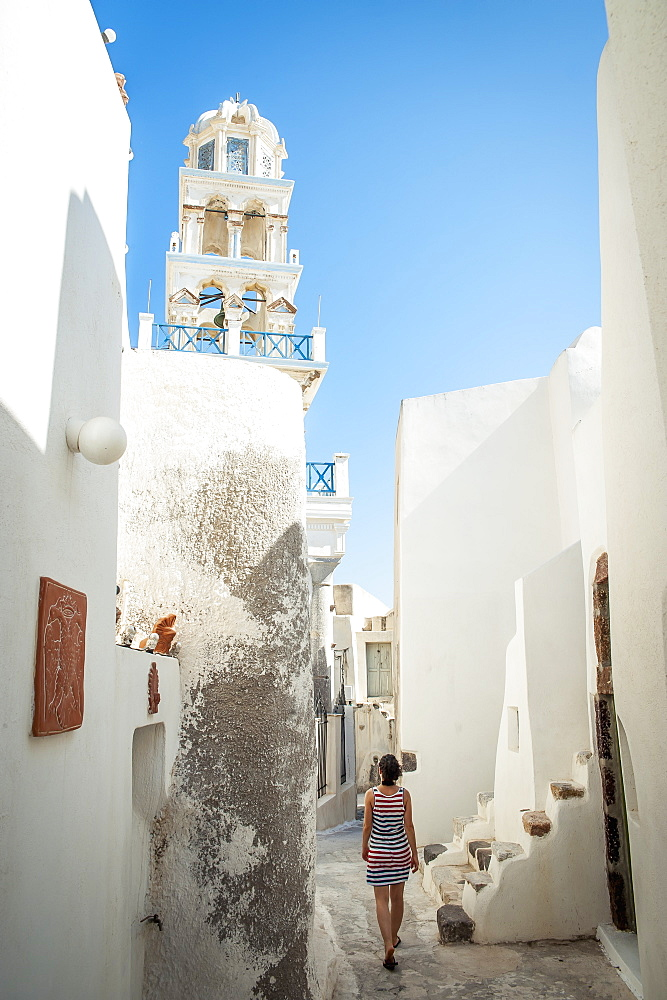 A Woman Walks Between Whitewash Buildings, Megalochori, Santorini, Greece