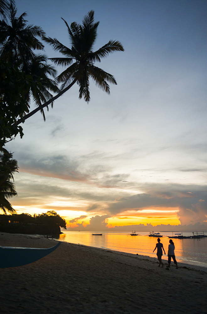 Beautiful Sunrise In Alona Beach, Friends Walking On The Sand, Panglao Island, Bohol, Philippines