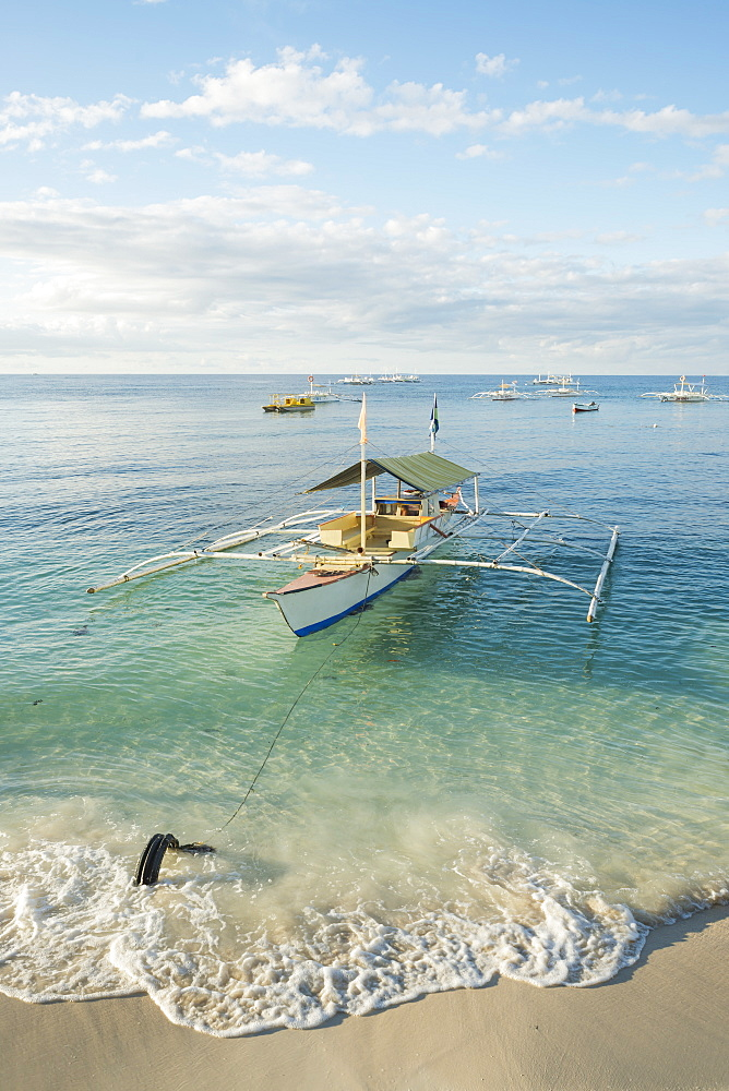 Boats On The Crystal Waters Of Alona Beach, Panglao Island, Bohol, Philippines