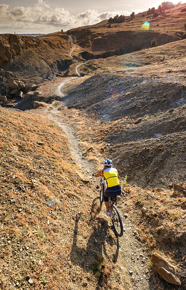 Woman Riding A Mountain Bike On A Rugged Trail, Tarifa, Cadiz, Andalusia, Spain