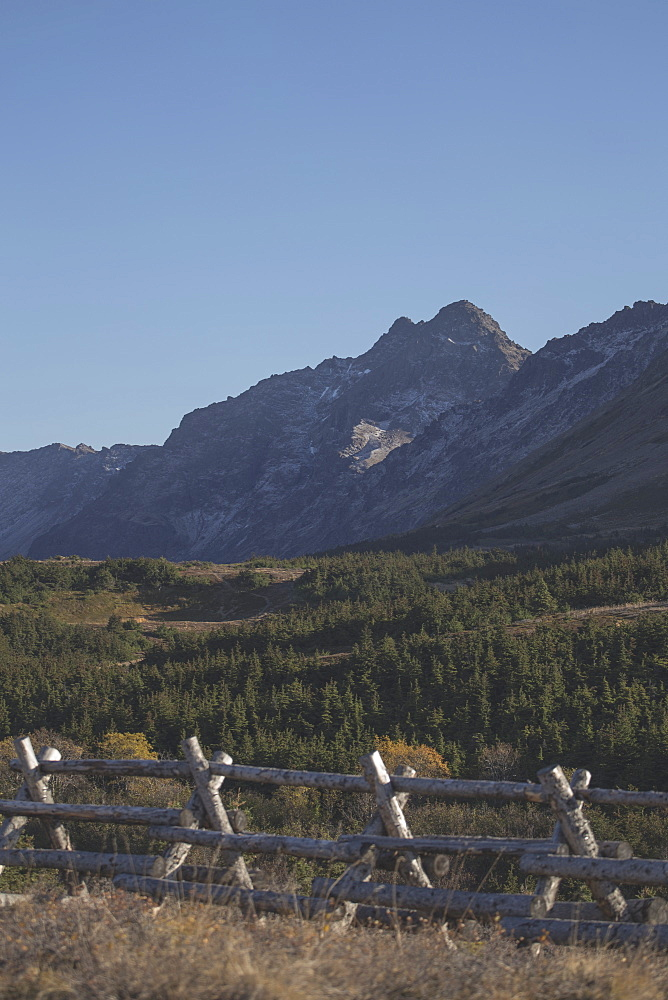 Scenic View Of Chugach Mountains With A Log Fence In The Foreground, Southcentral Alasak, Autumn