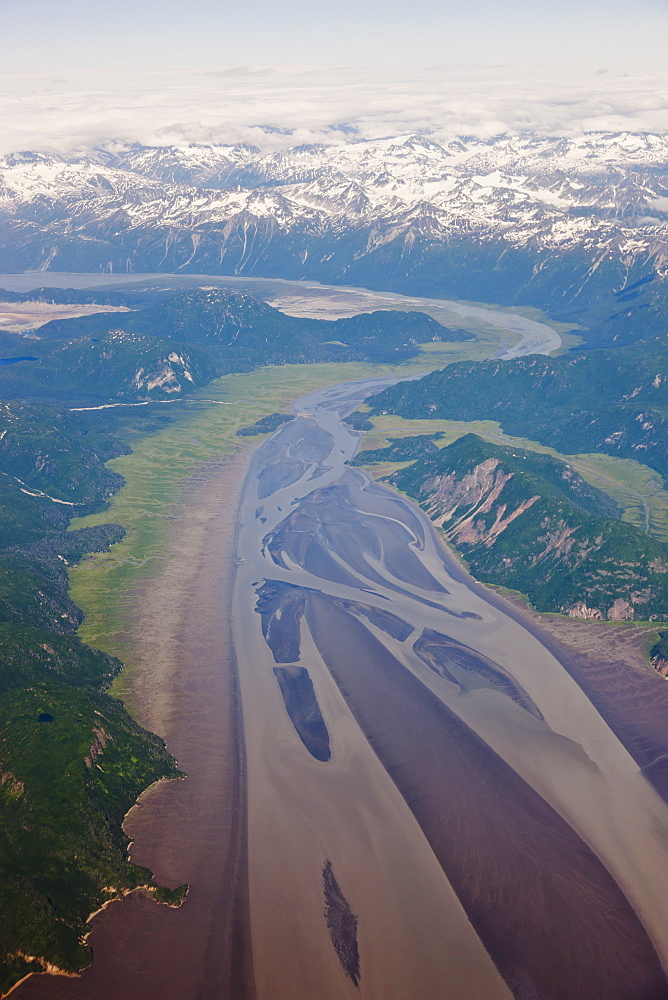 Aerial View Of Snow-Capped Peaks Surrounding A Green River Valley, Aleutian Range, Alaska Peninsula, Southwestern Alaska, USA, Summer