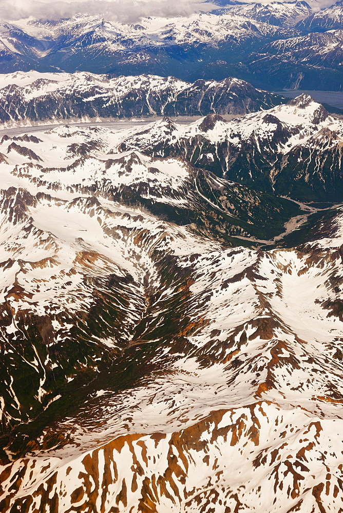 Aerial Perspective Of Glaciers, Fjords, And Snow-Covered Moutains In The Aleutian Range, Alaska Peninsula, Southwestern Alaska, USA, Summer