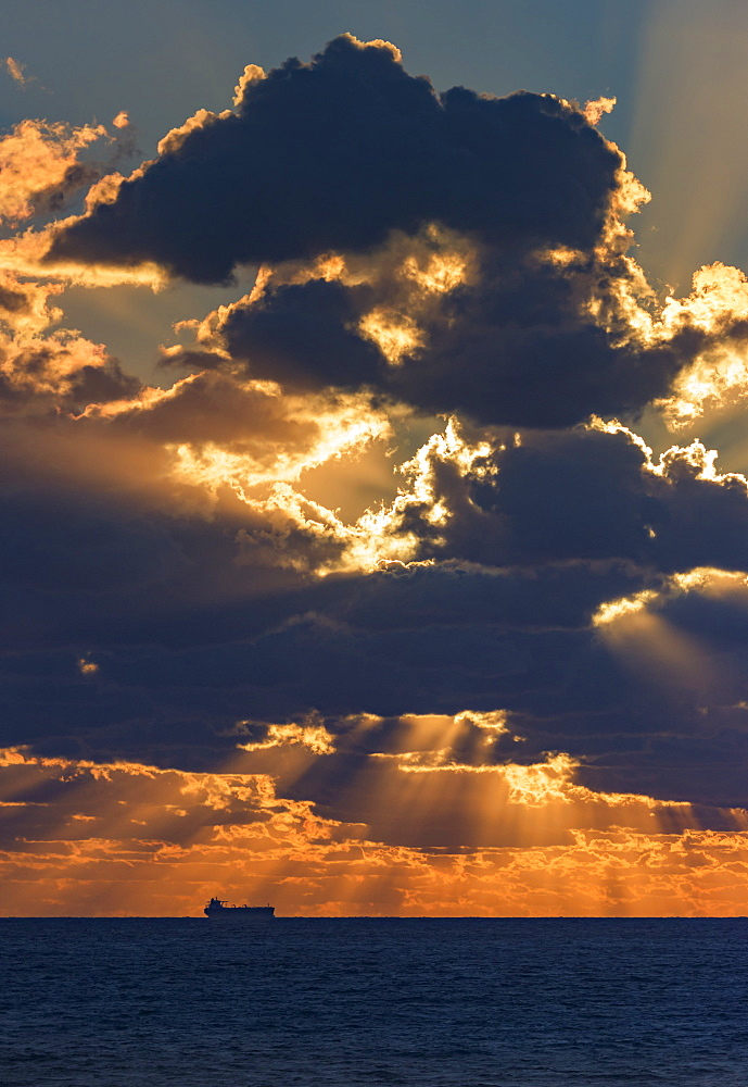 Dramatic Sky With Clouds Glowing At Sunset Over The Ocean And A Ship In The Distance, Tarifa, Cadiz, Andalusia, Spain