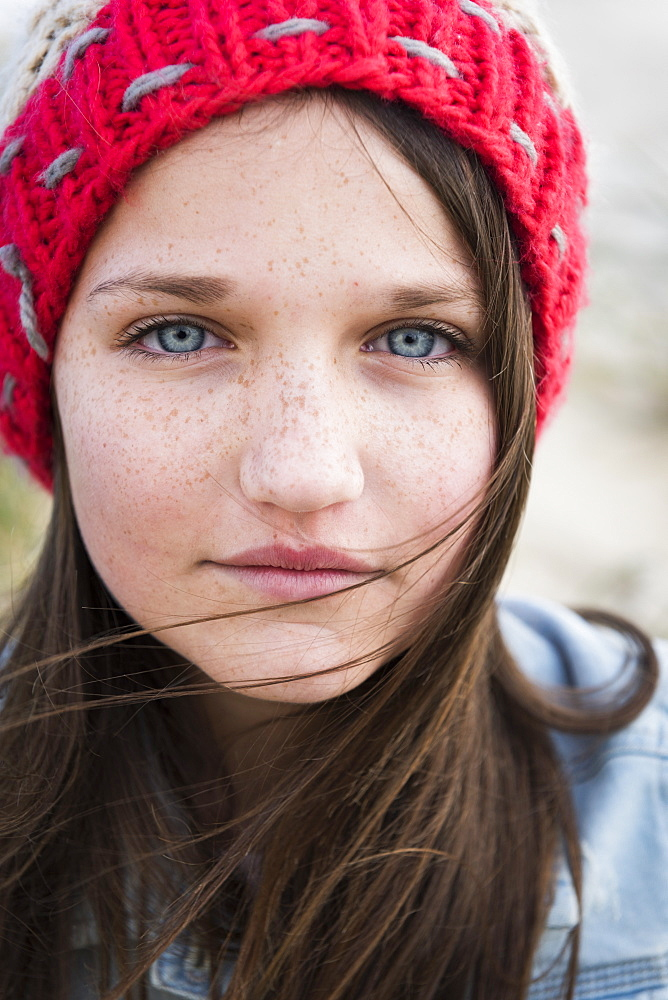 Portrait Of A Young Woman With Freckles, Blue Eyes And Long Brown Hair, Tarifa, Cadiz, Andalusia, Spain