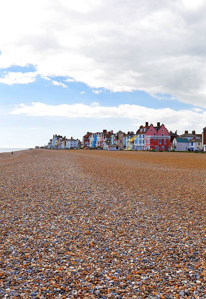 Empty Beach With Colourful Resort Houses In The Distance, Aldeburgh, Suffolk, England