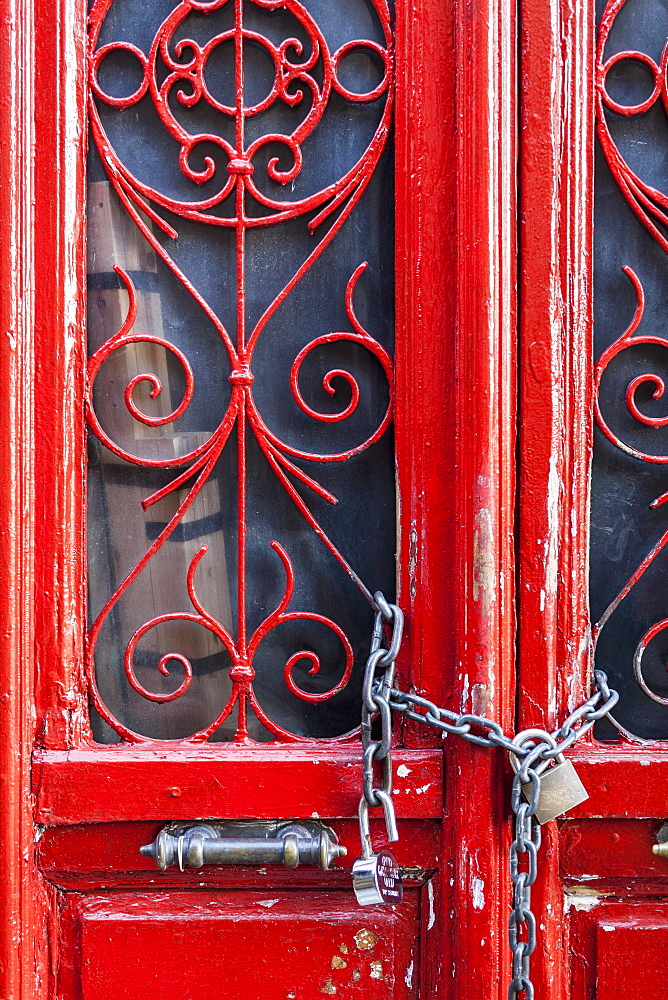 Red Door With Decorative Windows Chained Shut With A Padlock, Athens, Greeec