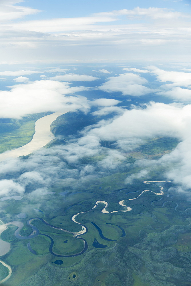 Aerial View Of Patchy Clouds Over The Yukon River, Alaska, United States Of America