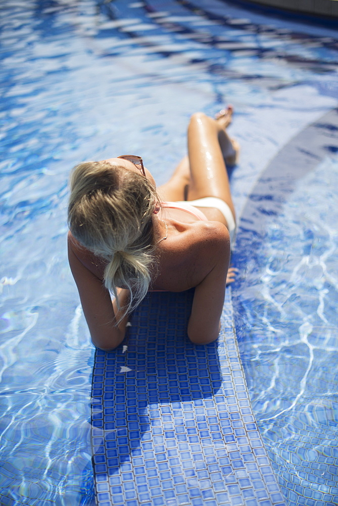 Woman At A Resort Enjoying The Pool, Island Of Hawaii, Hawaii, United States Of America