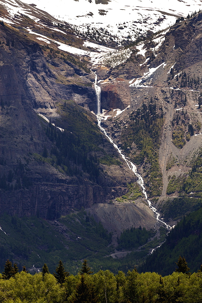 Distant Mountain Waterfall And Cascading Stream Tumbling Down The Mountainside, Colorado, United States Of America