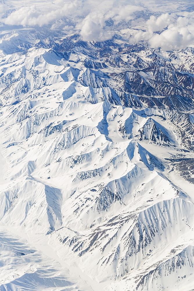 Aerial View Of Snow Covered Mountains In The Alaska Range, Interior Alaska, USA, Winter