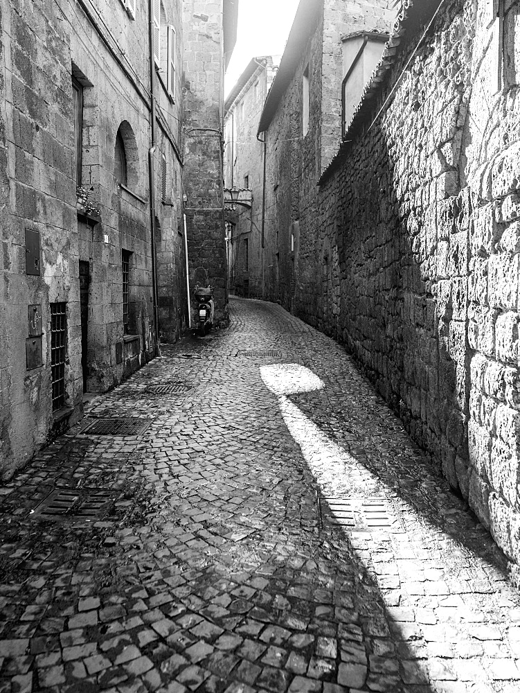 Narrow Cobblestone Alley Between Buildings, Orvieto, Umbria, Italy