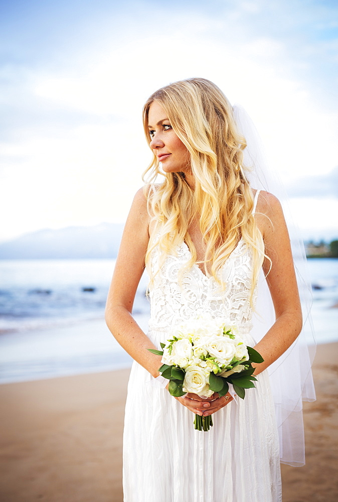 Beautiful Bride In Wedding Dress With Flowers At Sunset On Beautiful Tropical Beach In Hawaii