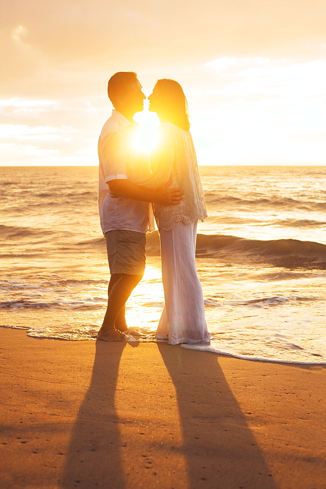 Romantic Mature Couple Kissing At Sunset On The Beach