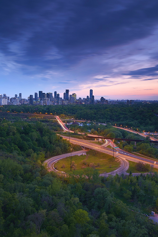 Sunset Looking South Over The Don Valley, Bloor On-Ramp, Toronto Skyline And Don Valley Parkway, Toronto, Ontario, Canada