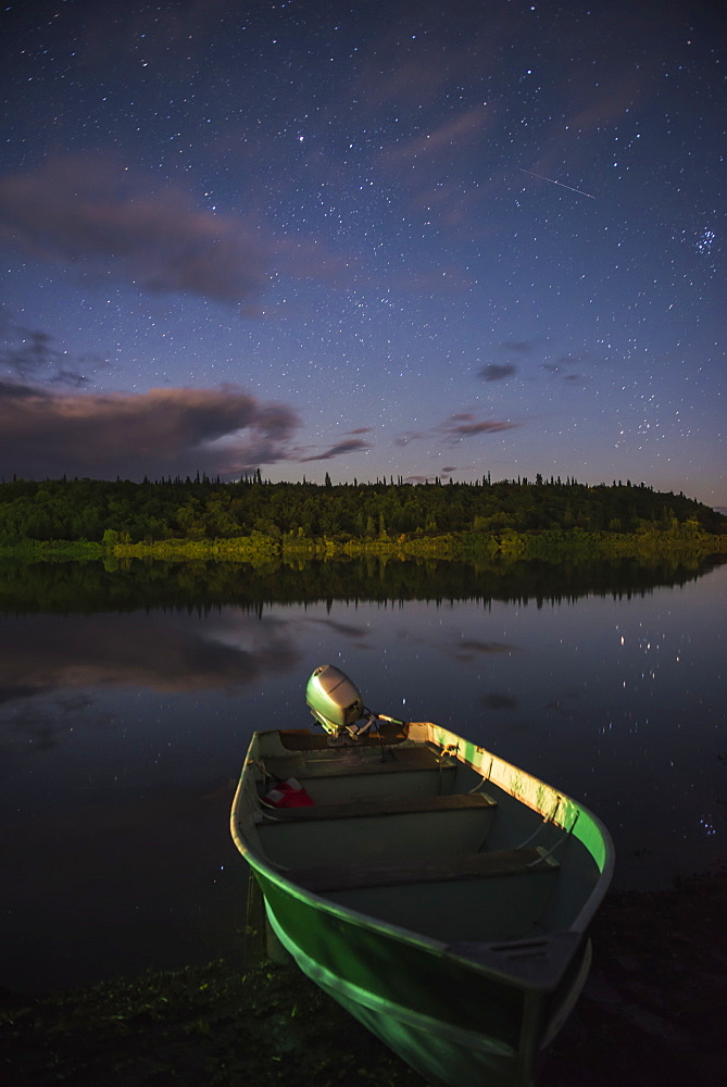 A Skiff Rests On The Banks Of The Kvichak River At Night, Bristol Bay Region, Southwest Alaska.