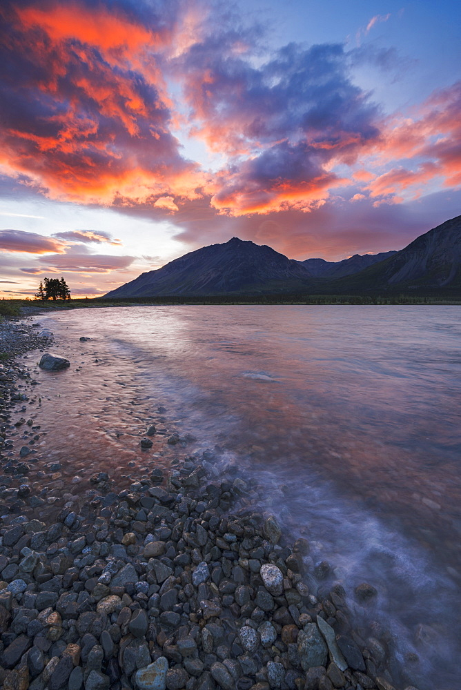 Colors Of Sunset Fill The Sky Over Upper Twin Lake In Lake Clark National Park & Preserve, Alaska.