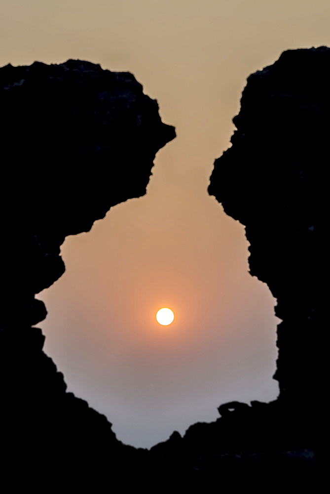 Sunrise Seen Through A Hole In An Old Stone Wall Without A Cloud In The Sky, Rampura Bas Ganwar, Rajasthan, India