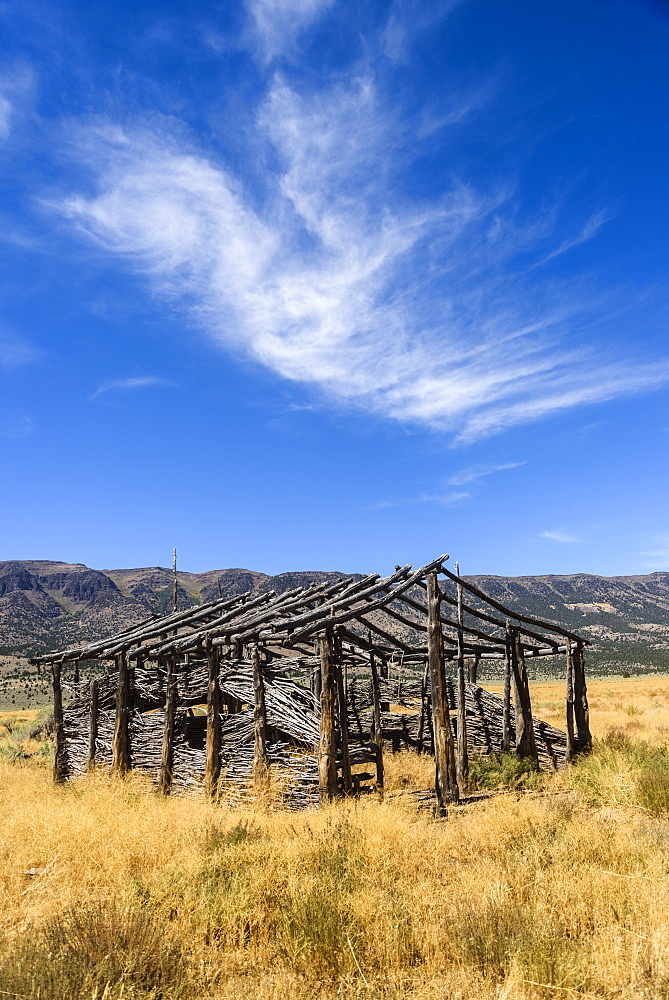 A Cloud Watches Over An Old Homestead, Fields, Oregon, United States Of America
