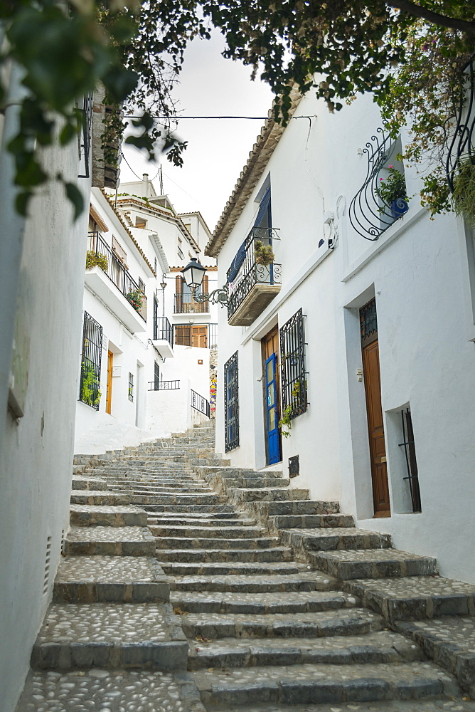 Steps Up A Sloped Street In The Beautiful Town Of Altea In Costa Blanca, Where The Houses Are Painted With The Typical Mediterranean Colours, White Walls And Blue Doors And Windows, Altea, Alicante, Spain