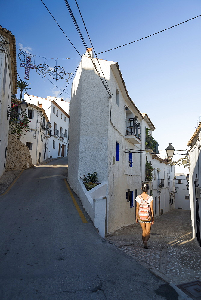 A Chinese Young Woman Walking On The Street Of The Beautiful Town Of Altea In Costa Blanca, Altea, Alicante, Spain