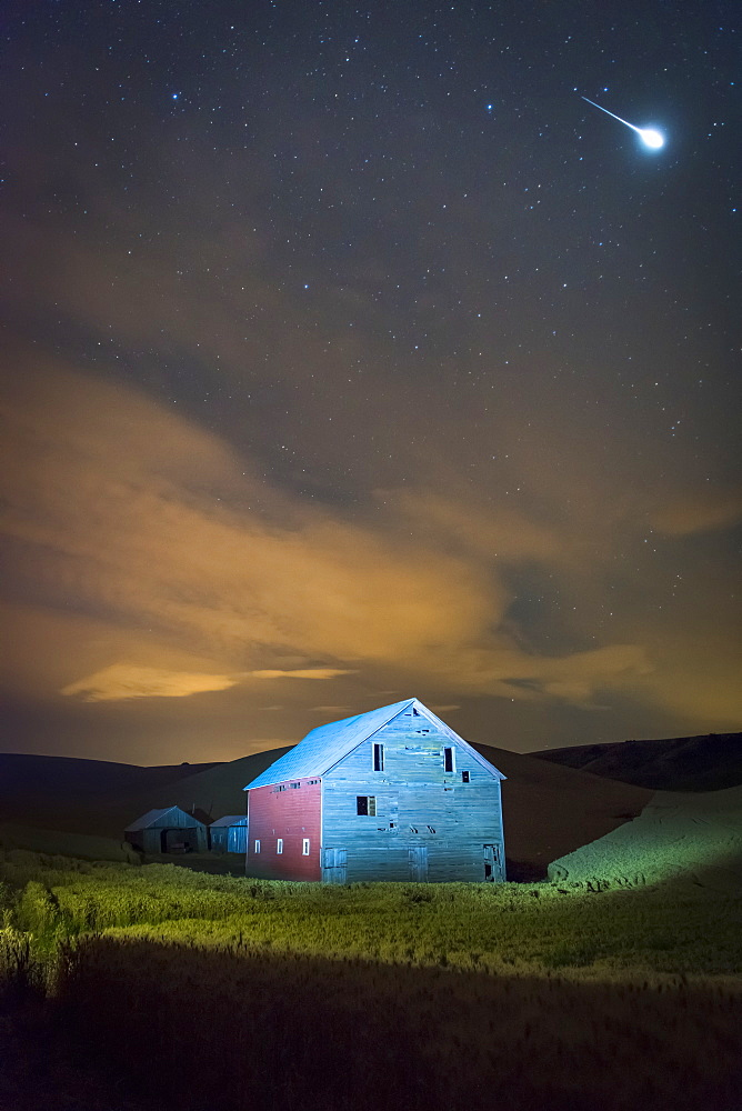 Stars And Constellations Above A Farmhouse And Barn In A Wheat Field At Night, Palouse, Washington, United States Of America
