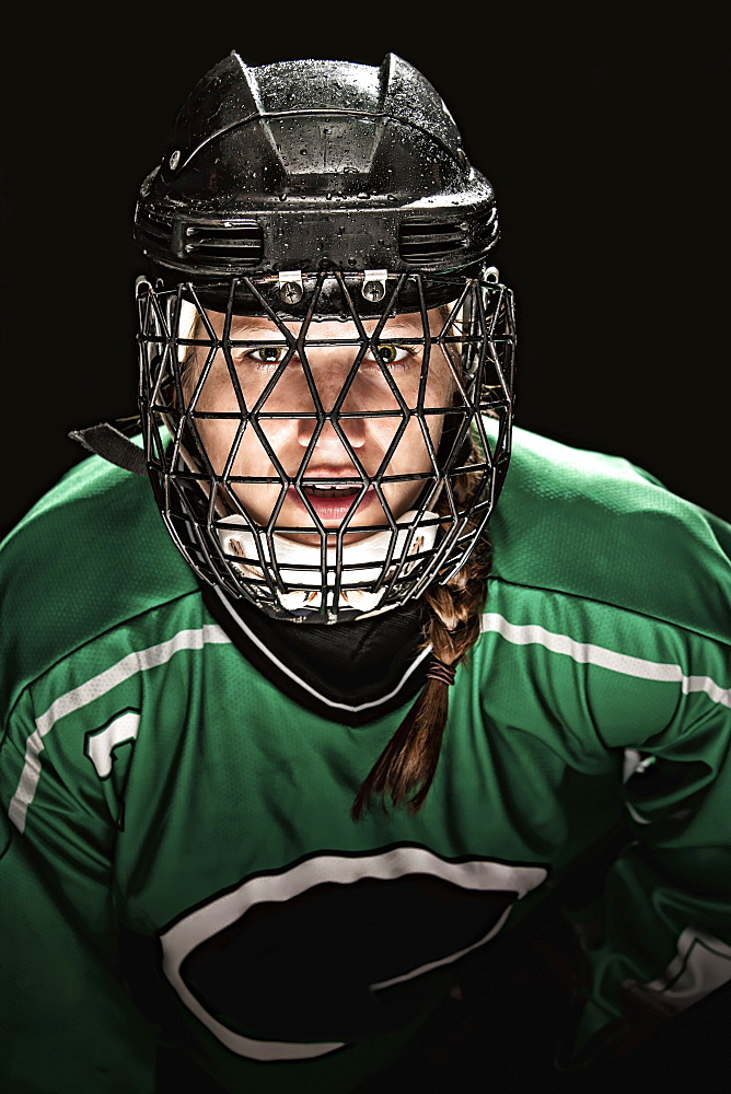 Ringette Player Wearing Green Jersey With Helmet And Cage, Regina, Saskatchewan, Canada