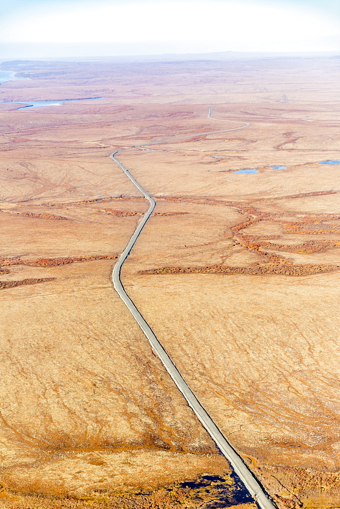 Aerial View Of Autumn Coloured Tundra Surrounding The Gravel Road Which Connects St. Mary's To Mountain Village, Yukon Delta, Arctic Alaska, Saint Mary's, Alaska, United States Of America