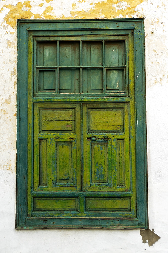 Weathered Green Wooden Window With Light Green Shutters In Weathered White Stucco Wall, Lanzarote, Canary Islands, Spain