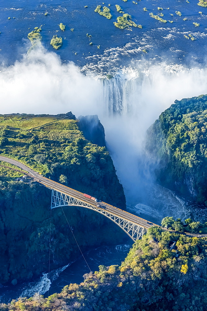 Aerial View Of Victoria Falls Behind Bridge, Botswana