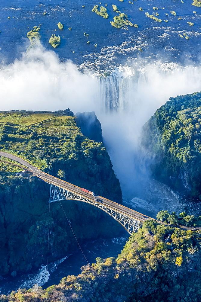 Aerial View Of Victoria Falls Behind Bridge, Botswana