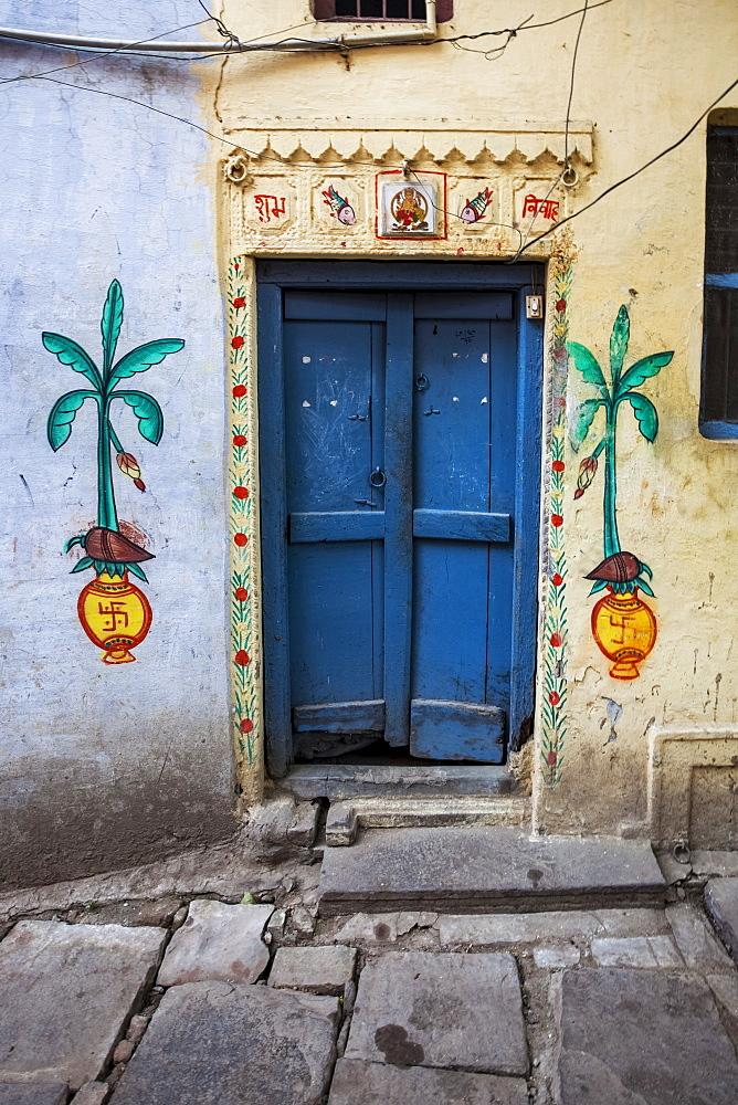 A Door To A Home Painted With Local Hindu Motifs, Including Hindu Swastikas, Varanasi, India