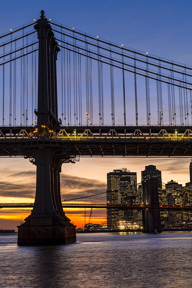 Sunset Behind Manhattan And Brooklyn Bridges, New York City, New York, United States Of America