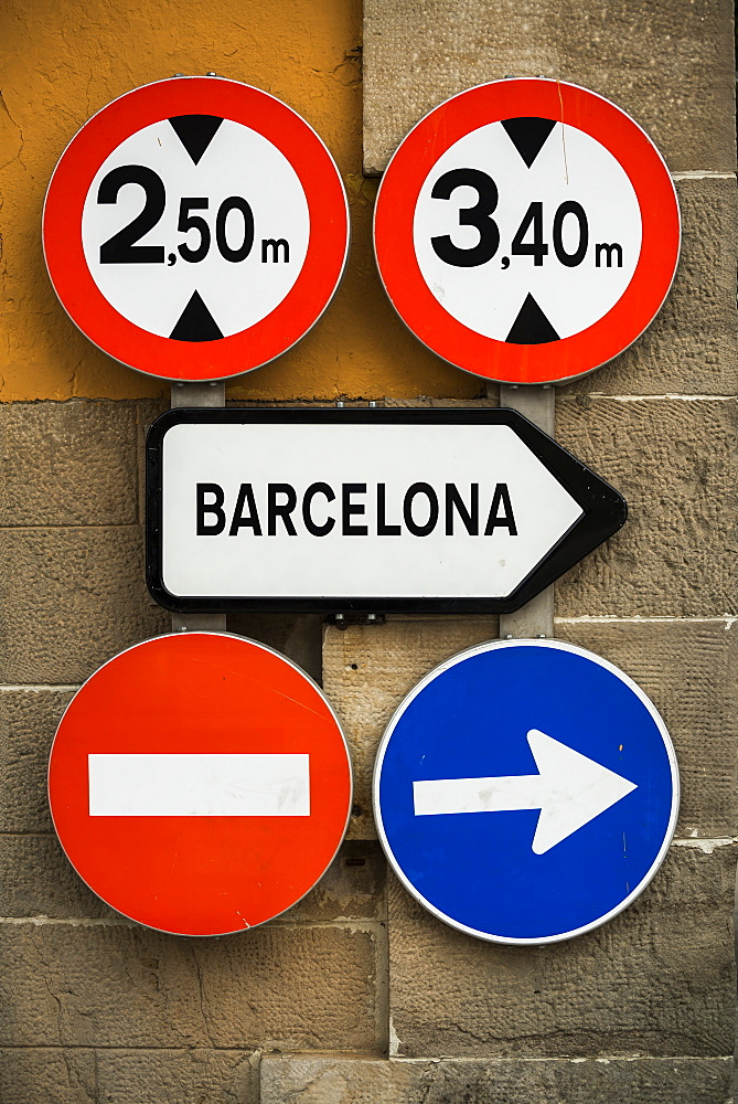Road Signs Mounted On A Wall, Barcelona, Catalonia, Spain