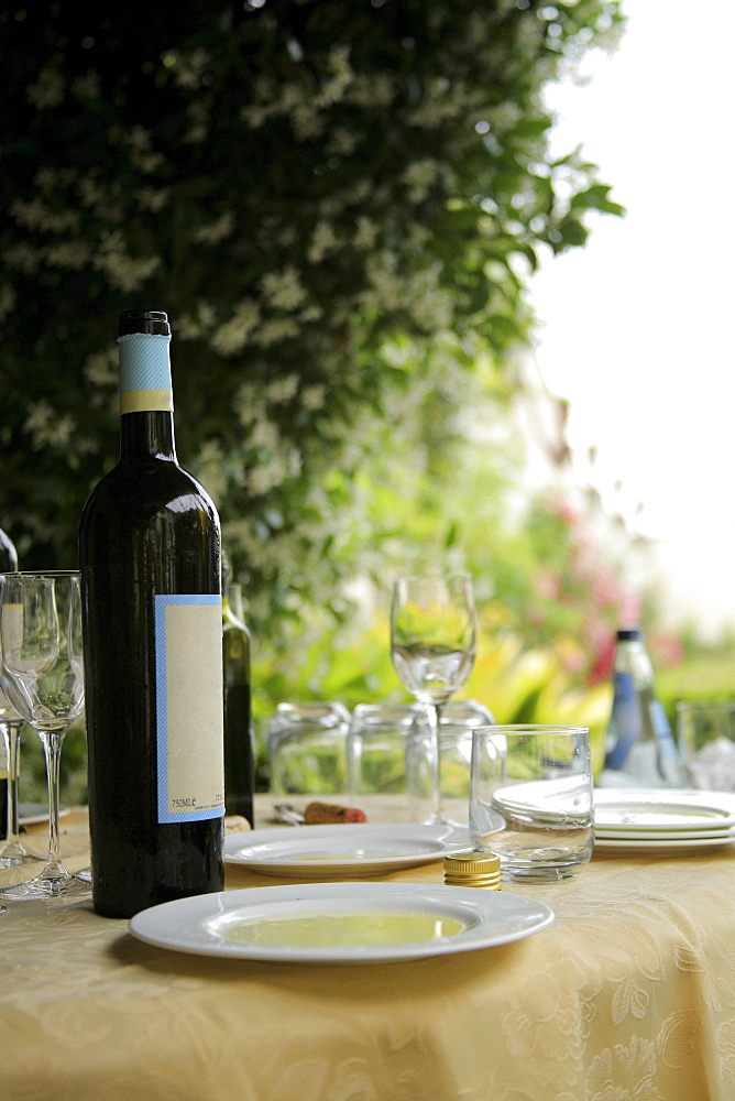 Tuscany, Italy; Table Set With Wine Glasses And Olive Oil