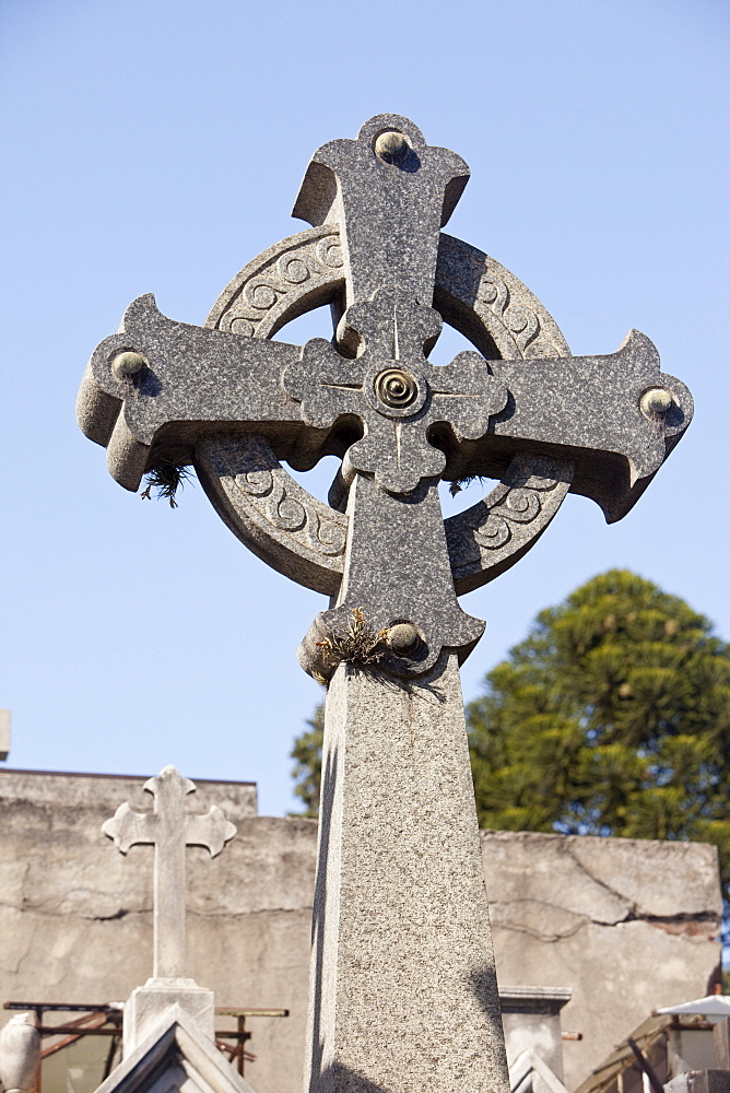 Buenos Aires, Argentina; A Stone Cross On A Tomb In Recoleta Cemetery