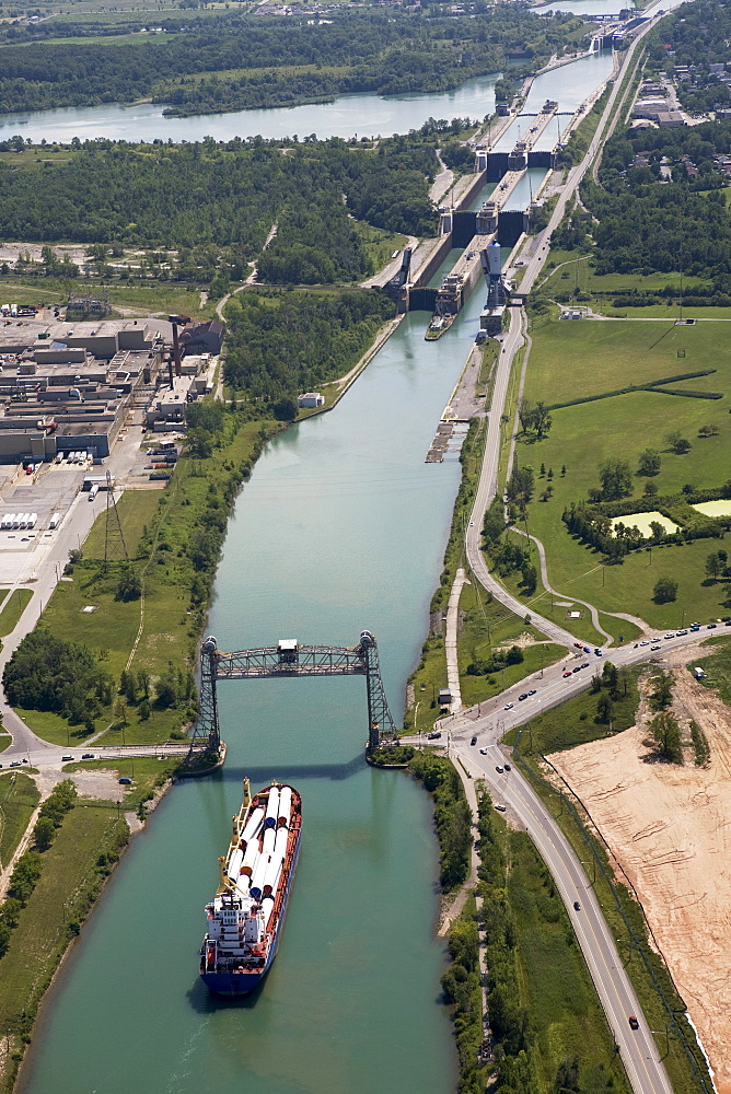 Welland Canal With A Ship, Bridge And Locks; Thorold, Ontario, Canada
