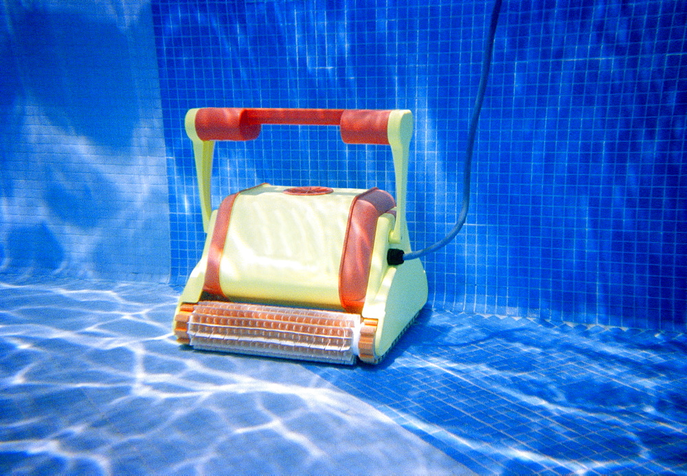 Pool cleaner underwater in swimming pool