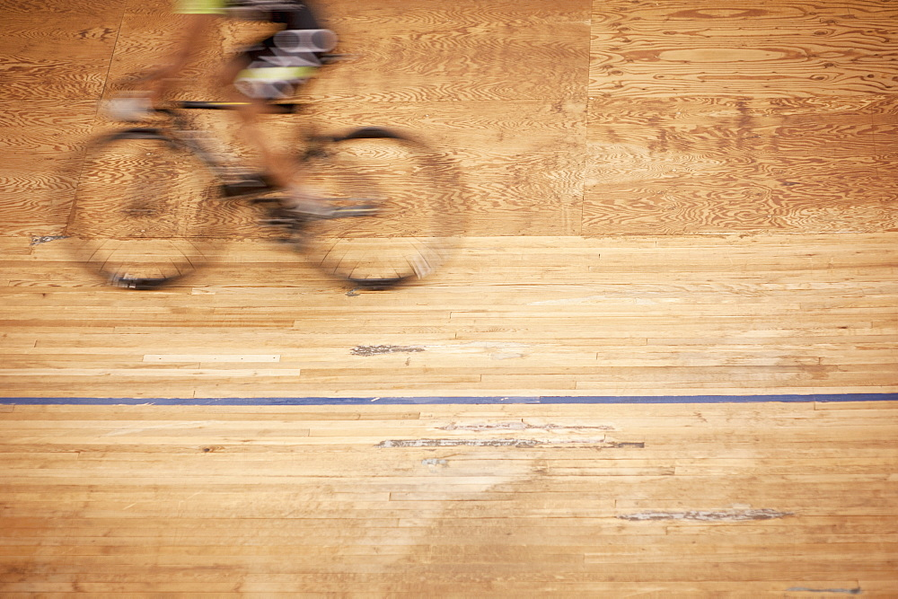 Blurred motion of cyclist racing on track