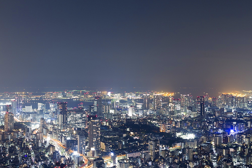 Aerial view of illuminated cityscape against sky at night
