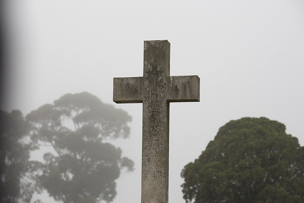 Cross at cemetery against clear sky, Melbourne, Victoria, Australia